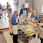 TASTY CUISINE: BankNewport employees take part in an Italian cooking class as part of a raffle prize for those who donated to the BankNewport 2019 United Way campaign. / COURTESY BANKNEWPORT