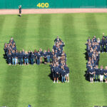 "BY THE NUMBERS: Employees of Starkweather & Shepley Insurance Brokerage Inc. form a giant ""140"" during an annual employee appreciation day at McCoy Stadium in Pawtucket to celebrate the firm's 140th anniversary. / COURTESY STARKWEATHER & SHEPLEY INSURANCE BROKERAGE INC."