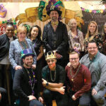 PICTURE PERFECT: Tockwotton on the Waterfront employees pose during a recent company Mardi Gras office party.COURTESY TOCKWOTTON ON THE WATERFRONT