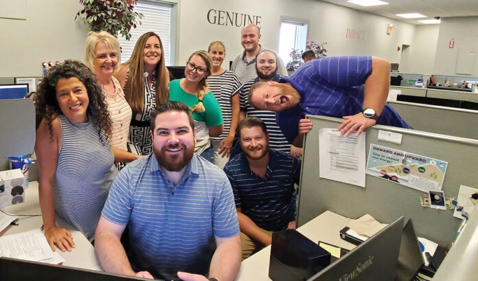 EARNING THEIR STRIPES: Vertikal6 employees participate in the company's Striped Shirt Day at the office. / COURTESY VERTIKAL6