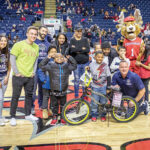 HOT WHEELS: Barnum Financial Group employees participate in the Foundation for Life's Bikes for Kids program. COURTESY BARNUM FINANCIAL GROUP