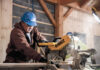 FRESH CUT: Pariseault Builders Dan Menard works on a table saw during a company project. / COURTESY PARISEAULT BROTHERS