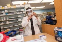 AT THE READY: Julia Tiberi, CVS pharmacy manager in Cumberland, prepares a dose of the flu vaccine. / PBN PHOTO/MICHAEL SALERNO