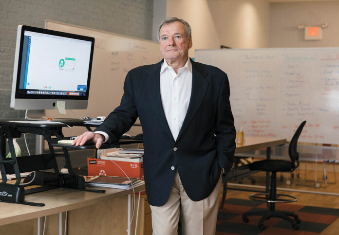 fancy footwork: Phoenix NeuroStim Therapeutics President Steven Metzger in his company's Providence office, which is bringing to market vibrating soles to help people with diabetes. / PBN PHOTO/RUPERT WHITELEY