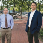 WALK IN THE PARK: Textron Inc. executive counsel Jamieson Schiff and Textron Director of Site Remediation and Sustainability Gregory Simpson helped revive Providence's Mashapaug Park in the city's Reservoir / PBN PHOTO/RUPERT WHITELEY