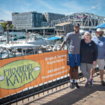 IN DEMAND: From left, Randall Ferdinand, Providence Kayak Co. employee; Kristin Stone, owner; and Tom McGinn, captain. The company, which was started three years ago, exploded in popularity this past summer, as people wanted to get outside. / PBN PHOTO/MICHAEL SALERNO