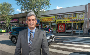 LATINO ADVOCATE: Oscar Mejias, CEO of the Rhode Island Hispanic Chamber of Commerce, stands along Westminster Street in the Olneyville section of Providence that features an enclave of Latino-owned businesses.  / PBN PHOTO/MICHAEL SALERNO