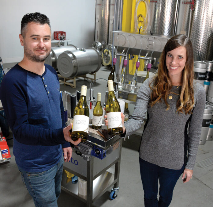 ALTERNATIVE PACKAGING: James Davids and Marissa Stashenko, co-owners of negociant winery Enotap LLC in East Providence, say using more-responsible packaging, such as cans and kegs, is better for the environment and costs less for consumers. / PBN PHOTO/ELIZABETH GRAHAM