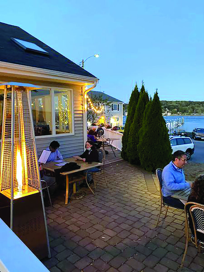 BY THE FIRE: 15 Point Road Restaurant in Portsmouth turned on the outdoor heaters in the first weekend of October. Proprietors Sean and Carly Smith said the heaters arrived after being on back order for months. / COURTESY 15 POINT ROAD RESTAURANT
