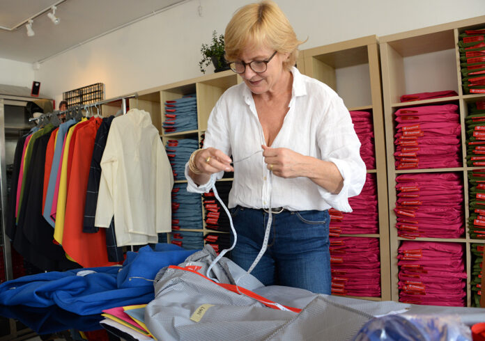 NEW CUSTOMERS: Cleverhood LLC owner Susan Mocarski stepped up international marketing when domestic sales of the company's outerwear dried up earlier this year. International sales are up 450% since April. / PBN FILE PHOTO/ELIZABETH GRAHAM