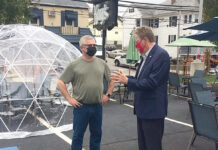 "WEATHER OR NOT: Lt. Gov. Daniel J. McKee gets a closer look at an ""igloo"" set up at Kay's Restaurant in Woonsocket. With McKee is Kay's owner David Lahousse. Ten of the structures, which cost over $1,400 each, are now in place at the restaurant to extend outdoor dining. / COURTESY OFFICE OF LIEUTENANT GOVERNOR"