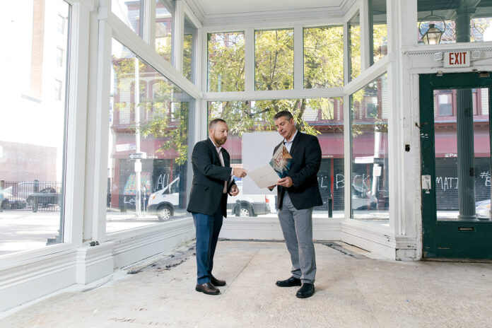 SEEKING TENANTS: Daniel Feiner, left, and Michael Volpe are vice presidents at MG Commercial Real Estate Services Inc. and brokers for the vacant storefronts at 183-185 Mathewson St. in Providence, pictured, which are ready for tenants. / PBN PHOTO/RUPERT WHITELEY