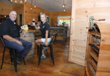 FRUITS OF LABOR: About a decade ago, John and Maureen Leyden, owners of Leyden Vineyards and Winery LLC in West Greenwich, began planting seeds for strawberries, blueberries and grapevines on their Christmas tree farm property and in 2011 began making and selling fruit-essence wines. / PBN PHOTO/ELIZABETH GRAHAM