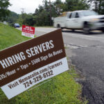 U.S. JOBLESS CLAIMS totaled 840,000, last week . / AP FILE PHOTO/GENE J. PUSKAR
