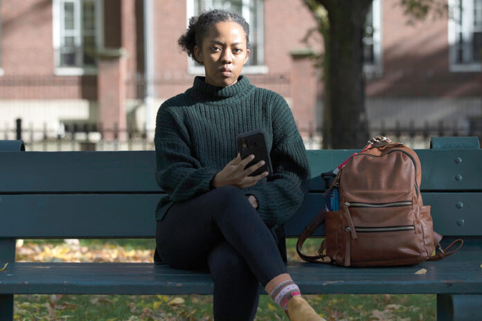 STAYING ALERT: Harvard University graduate student Maya James received an email from a political action committee that seemed harmless: if you support Joe Biden, it urged, click here to check if you're registered to vote. A little research indicated that it was a phishing scam.  / AP PHOTO/