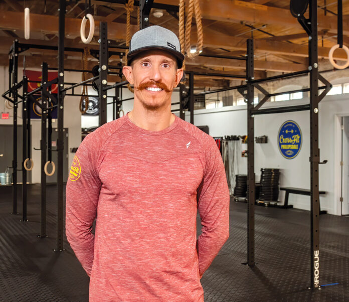 PASSIONATE PURSUIT: Phillip Carroll opened the CrossFit Phillipsdale gym in East Providence in March. / PBN PHOTO/MICHAEL SALERNO