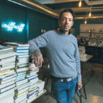 TURNING THE PAGE: Tom Roberge, co-owner of Riffraff Bookstore + Bar, is hopeful that online book sales will increase when and if the business's outdoor patio, now open daily with limited hours, closes in the winter. / PBN PHOTO/RUPERT WHITELEY