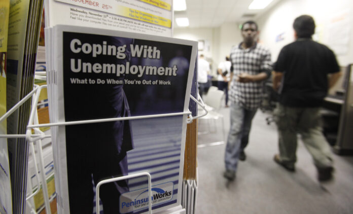 THERE WERE 74,386 Rhode Islanders who claimed some form of unemployment benefit, including pandemic unemployment assistance, for the week ended Oct. 25. / AP FILE PHOTO/PAUL SAKUMA