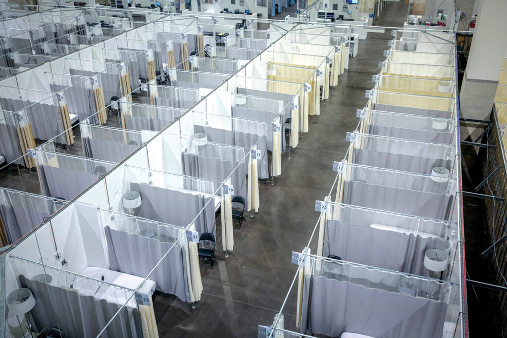 THE PAYOUT: The state has allocated tens of millions of dollars in CARES Act funding, including to build field hospitals such as the one pictured at the R.I. Convention Center. But now a Dec. 30 deadline to spend the rest of stimulus funding is fast approaching. / COURTESY LIFESPAN CORP.