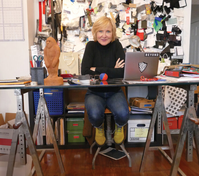 Designer Susan Mocarski founded Providence-based Cleverhood LLC in 2010. The outerwear company designs and sells high-performance rain capes internationally. / COURTESY CLEVERHOOD LLC