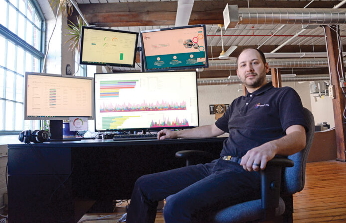 """WELL-ROUNDED: NeQter Labs CEO Richard Astle says he learned the importance of hiring """"people smarter than me"""" to offset his areas of weakness and strengthen the software company, which he said has had its best year ever in 2020. / PBN PHOTO/ELIZABETH GRAHAM"""