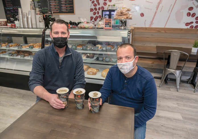 HASN'T BEEN EASY: Terry Coburn, left, and Brian Buonaiuto, co-owners of Coffee and Crumbs in Cranston, opened their shop just weeks before the COVID-19 pandemic arrived in March. 