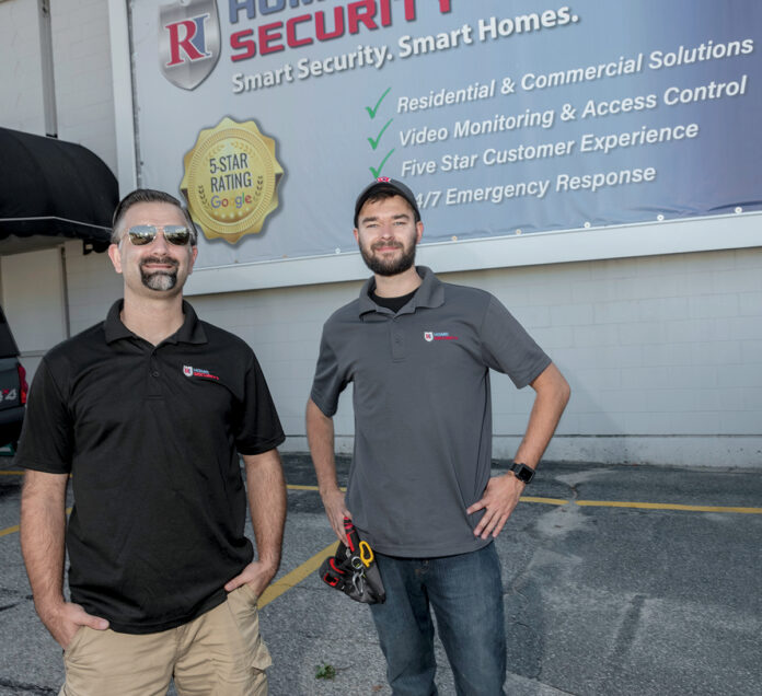 REST ASSURED: Jake Murray, left owner of RI Home Security LLC, with lead technician Hunter Murray. / PBN PHOTO/MICHAEL SALERNO