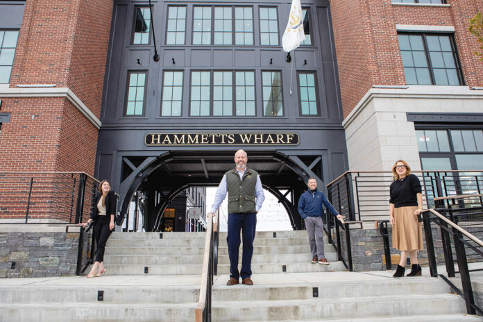 LOOKING AHEAD: Hammetts Hotel opened in Newport in June. Owners don't expect to lay anyone off this winter. From left: General Manager Randi Milewski; Colin Kane and Sam Bradner, two owners; and Sarah Eustis, CEO of the Main Street Hospitality Group, which is managing the hotel. / PBN ARCHIVE PHOTO/KATE WHITNEY LUCEY