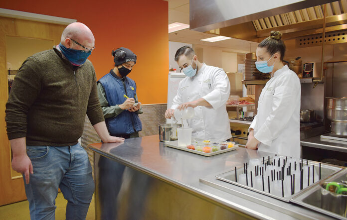 MIXING materials: Blount Fine Foods Corp. positional instructors, from left, Mike Smith and Eddy Anlen, learn about starches from research and development chefs Clayton Burrows and Leanne Koch./COURTESY BLOUNT FINE FOODS CORP.