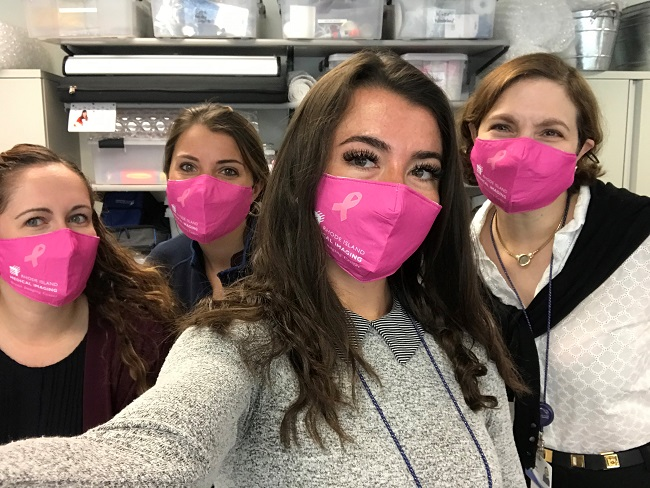 RHODE ISLAND MEDICAL IMAGING staff members model specially designed pink face masks that the organization sold to commemorate Breast Cancer Awareness Month. / COURTESY RHODE ISLAND MEDICAL IMAGING