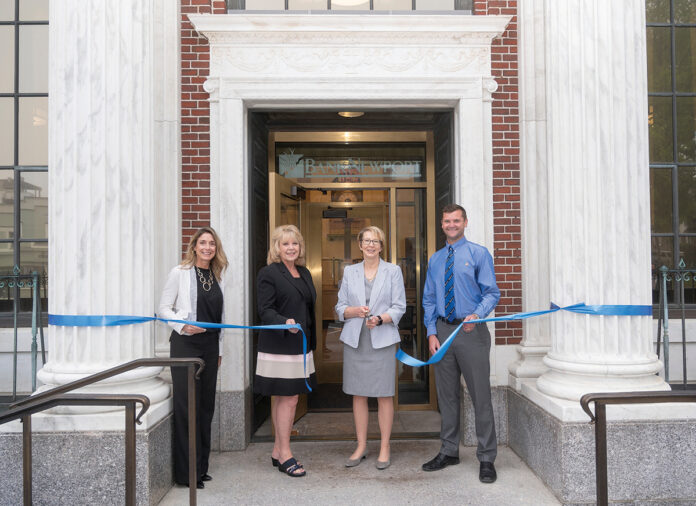 FRESH LOOK: BankNewport administrators cut the ribbon on the recently restored branch in Newport's Washington Square. Pictured, from left, are Amy Riccitelli, senior vice president and director of retail sales; Mary Leach, executive vice president and director of consumer relationships; Sandra J. Pattie, CEO and president; and Evan Rose, vice president and branch sales manager. / COURTESY BANKNEWPORT