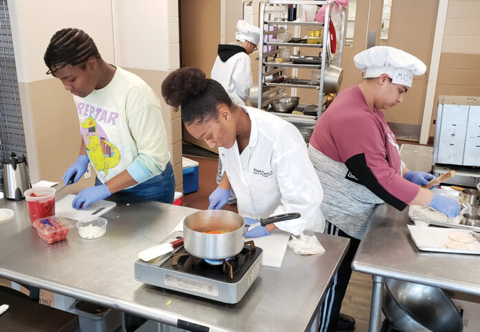 THE RIGHT INGREDIENTS: William M. Davies Jr. Career & Technical High School students, from left, Miracle Dunn, Aiden Nivar-Julius, Dorothy Tavares and Madyisen DaGraca sharpen their cooking skills in a culinary class.  / COURTESY WILLIAM M. DAVIES JR. CAREER & TECHNICAL HIGH SCHOOL