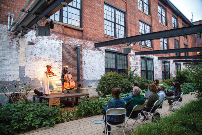 "SOUNDS OF SUMMER: Musicians Ashley Frith and Desmond Bratton perform for an outdoor audience during The Wilbury Theatre Group's ""Decameron, Providence"" event during the summer of 2020.  / COURTESY ERIN X. SMITHERS"