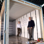 ACCESSORY UNIT: ADDASPACE co-founders Anders Hansen, right, and Andrew Naperotic stand inside of a module that is currently being customized in Bristol. / COURTESY ADDASPACE LLC
