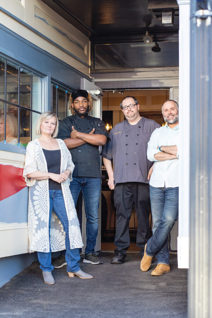 A FRESH TAKE: PB Bistro & Bar in East Greenwich is offering family-sized vegan and vegetarian dishes for the holidays. Patti Burton, far left, and Dan Hatch, far right, opened the plant-based eatery in the spring. With them are sous chef O'Laro Waite, second from the left, and executive chef Mike Fleury.  / COURTESY CAITLIN COSTA