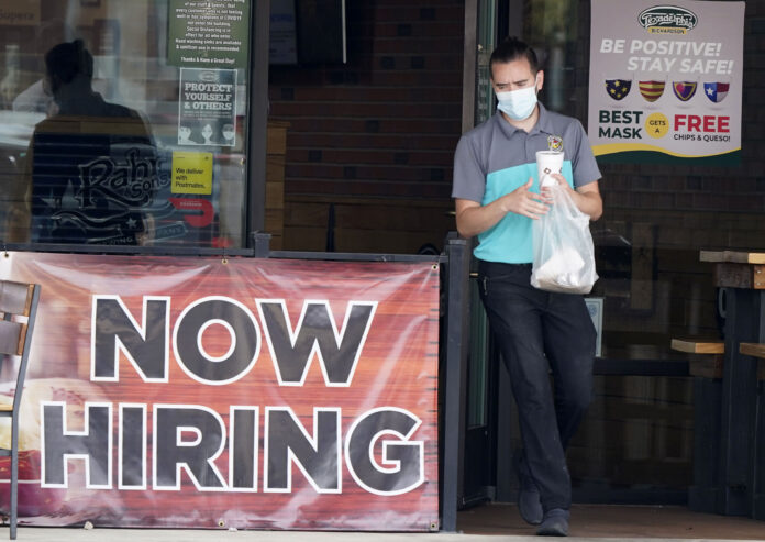 COVID-19-related unemployment insurance filings totaled 7,425 last week. / AP FILE PHOTO/LM OTERO