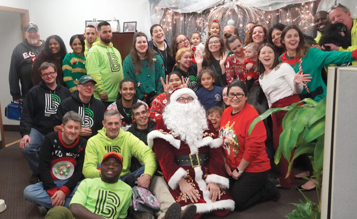 holiday cheer: Big Brothers Big Sisters of Rhode Island employees gather for a Christmas party at the office.COURTESY BIG BROTHERS BIG SISTERS OF RHODE ISLAND