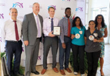"FEELING SAFE: In 2019, two Providence Community Health Centers locations were designated as LGBTQ ""Safe Zones"" by Blue Cross & Blue Shield of Rhode Island. From left are Dr. Andrew Saal, chief medical officer; Merrill Thomas, CEO and president; Michael Spoerri, health center director; Guillaume Bagal, former head of diversity and inclusion at Blue Cross & Blue Shield of Rhode Island; and health center staffers Maria Quiroa, Ester DaCruz and Diane Sette. / COURTESY PROVIDENCE COMMUNITY HEALTH CENTERS"
