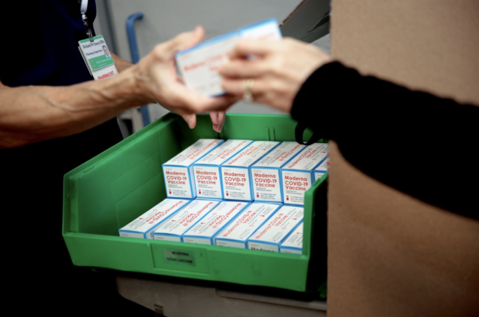 THE FIRST SHIPMENT of Moderna's COVID-19 vaccine is unpacked at Rhode Island Hospital on Dec. 22. / COURTESY LIFESPAN CORP./BILL MURPHY