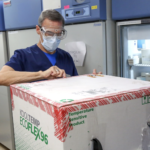LIFESPAN CORP. Pharmacy Supervisor Richard Emery unpacks the first shipment of Moderna's COVID-19 vaccine to arrive at Rhode Island Hospital on Dec. 22. / LIFESPAN CORP./BILL MURPHY