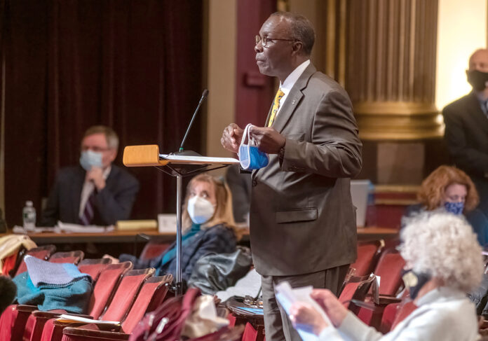 BUDGET TALK: Rep. Marvin L. Abney, D-Newport, chairman of the House Finance Committee, speaks during discussions before a full House vote last month on the $12.75 billion 2020-2021 state budget. House Speaker K. Joseph Shekarchi has said Abney will continue as finance chairman in the 2021 session. / PBN PHOTO/MICHAEL SALERNO