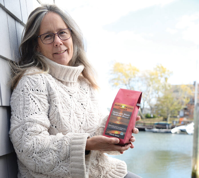COFFEE BREAK: Kerri Gaffett, owner of Block Island Coffee, takes a break from her psychotherapy business to show off one of her blends at her North Kingstown storefront. / PBN PHOTO/ELIZABETH GRAHAM