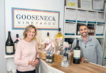 SCOURING THE GLOBE: Cousins Liana Buonanno and Paul Fede, co-owners of Gooseneck Vineyards, work with farmers in six countries to source the grapes for their classic, budget-friendly wines, which they sell in their North Kingstown vineyard shop.  PBN PHOTO/MICHAEL SALERNO