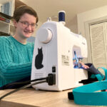 PERSONAL TOUCH: Diana Perkins created the LapSnap, a waterproof canvas bag, to allow wheelchair users to carry items when they go grocery shopping. She learned to sew so she could stitch 10 prototypes to send to test users. / COURTESY INCLUDESIGN LLC