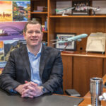 PEACE OF MIND: Jeffrey Roy, executive vice president of revenue management and pricing at Collette Travel Service Inc. in Pawtucket, says the company recently saw a 10% increase in travel insurance purchases. / PBN PHOTO/MICHAEL SALERNO