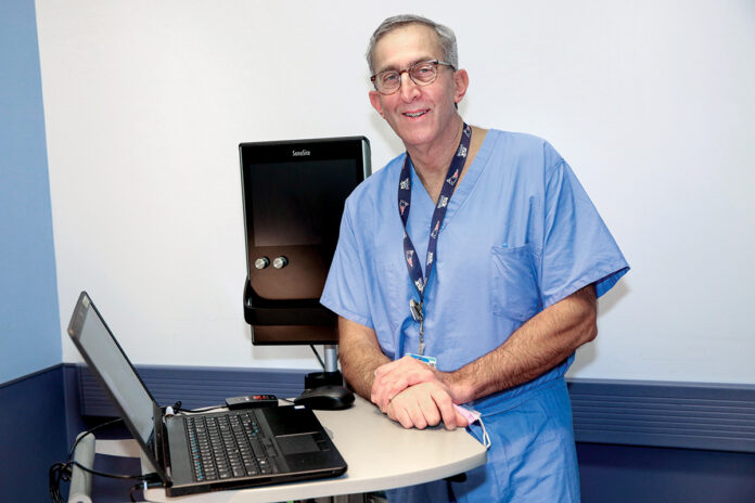 QUICK RECOVERY: Dr. John Froehlich, director of the Total Joint Center at The Miriam Hospital, says within the last year, the center has reduced its average hospital stay for patients having knees and hips replaced from four days to one day. / COURTESY LIFESPAN CORP./BILL MURPHY