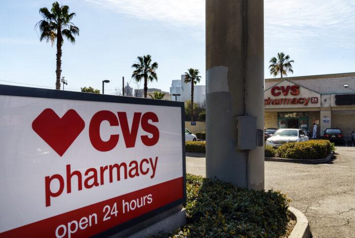 CVS HEALTH CORP. reported a profit of $7.2 billion profit in 2020. / AP FILE PHOTO/DAMAIN DOVARGANES