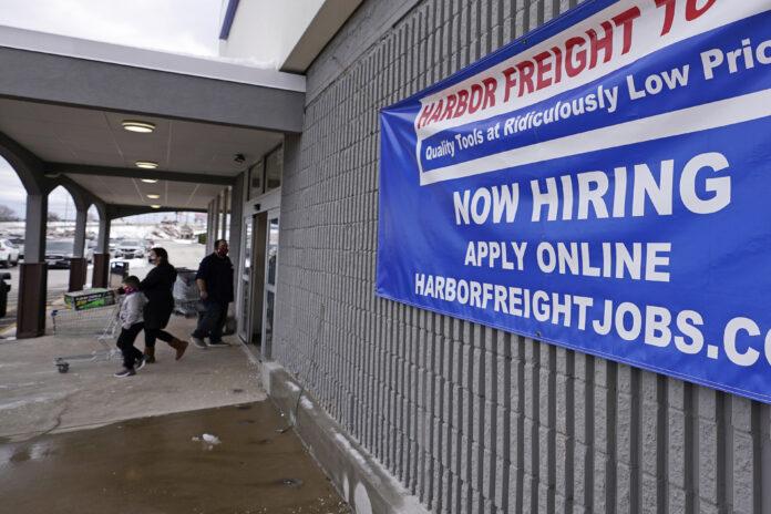 U.S. JOBLESS CLAIMS totaled 861,000 last week. / AP FILE PHOTO/CHARLES KRUPA