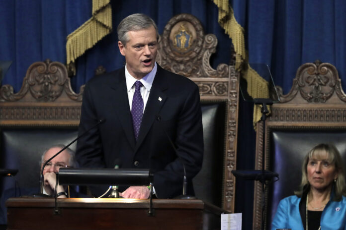 MASS. GOV. CHARLIE BAKER announced that the state is easing some of its COVID-19 restrictions by increasing the capacity limits on businesses to 40%. / AP FILE PHOTO/STEVEN SENNE