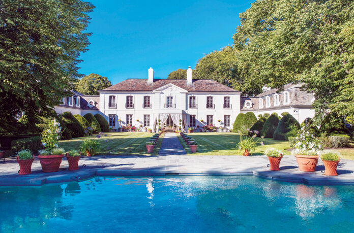 STATELY SURROUNDINGS: The 9-acre Ker Arvor estate at 275 Harrison Ave., Newport, sold on Dec. 29 to a Silicon Valley tech executive and his wife, a novelist, for $7.3 million. / Courtesy Lila Delman Real Estate